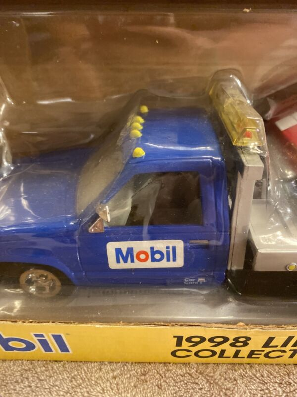 Mobil 1998 Flatbed Truck With Car