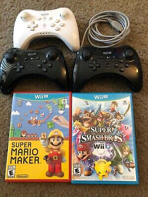 3 Nintendo Wii U Pro Controllers (WUP-005)And 2 Mario Games