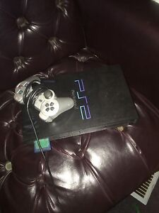 PS2 with 2 controllers and comes with games St. John's Newfoundland image 2