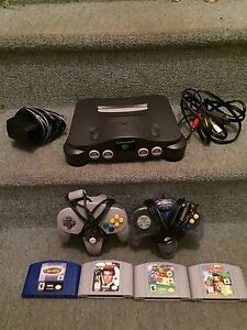 NINTENDO 64 + 4 jeux + Expension pak