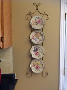 Wall plate holder with 4 plates