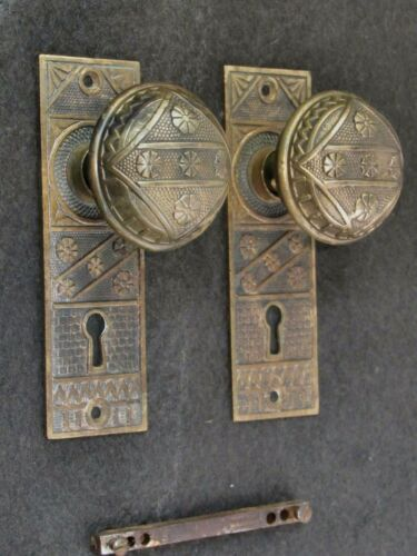 A Pair of Antique Brass F.C. Linde Door Knobs and Backplates