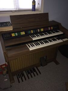 Lowrey organ and music books