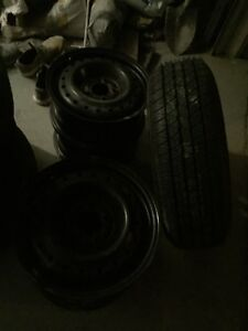 FOUR STEEL RUMS 15 INCH AND ONE BRAND NEW TIRE ON RIMOF TOYOTA