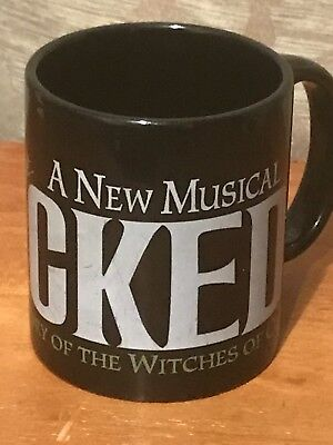 Wicked Musical Black Coffee Mug Broadway 10oz White and green text. Witch is grn