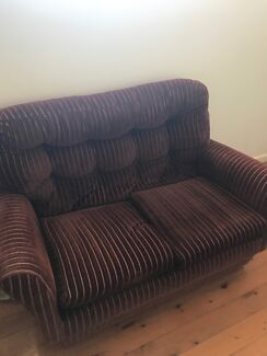 Brown corduroy small two-seater lounge.