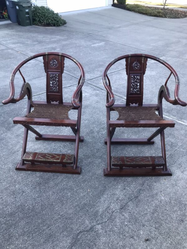 A pair of Antique Chinese Horseshoe Back Folding arm chairs