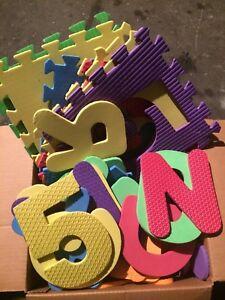 Big box of foam letter carpet pieces 32 squares