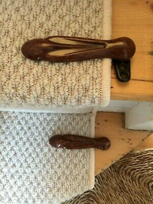 Pair of two marbled mid brown bakelite stair clips / grips