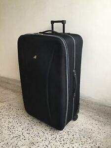 "EXTRA LARGE, rolling, suitcase/luggage, 30"" high"