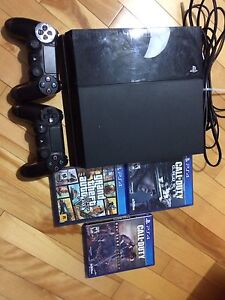 PS4 with 2 controllers and 4 games.