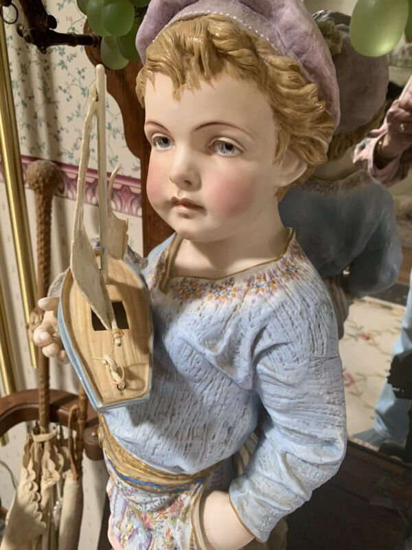 """antique bisque statue  large sailor boy with his toy sailboat 29"""" tall ."""