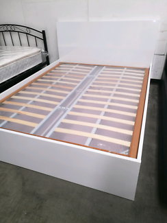 Brand new high gloss queen size bed with storage.