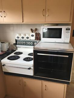 Elevated electric stove (cooker) and oven combination with grill