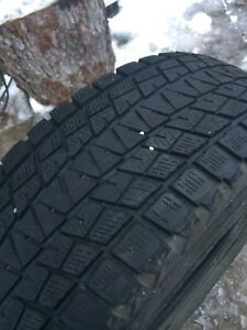 Bridgestone Blizzak 235/70/R16 winter tires.