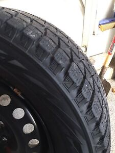 LIKE NEW. BLIZZAK WS80 WINTER SNOW TIRES ON RIMS