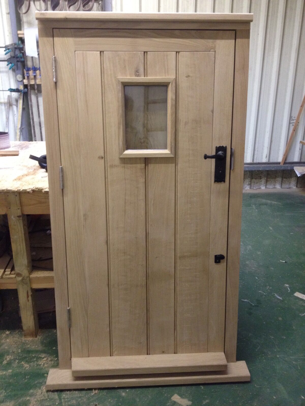 Solid oak framed ledge door and frame hardwood exterior for Outside doors and frames