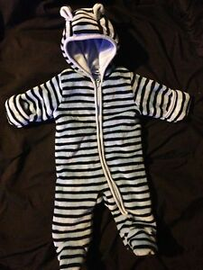 Baby's white and blue striped onesie snow suit