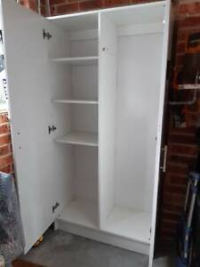 WHITE DOUBLE DOOR CUPBOARD WITH SHELVES AND BROOM SPACE