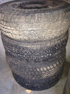 14 inch winter tires on rims ( used a mth)