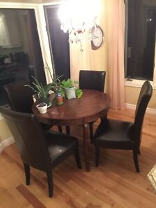 Round table with 4 sturdy chairs