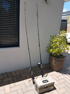 2 fishing rods and tackle box