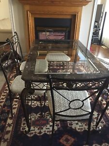 Dining table, made of steel , glass on top with 6 chairs
