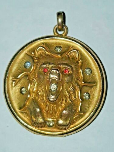 VICTORIAN ANTIQUE GOLD FILLED JEWELED REPOUSSED BEAR WITH PAWS  LOCKET