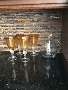 Wine glasses and water pitcher