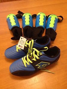 Soccer shoes and shin pads new