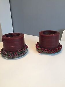 2 candles with stands