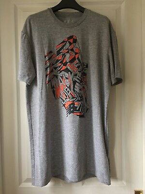 New Balance Short Sleeve Grey T-Shirt, Black and Orange Graphic, Size Euro Large