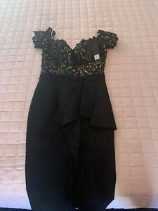Women's size 6 and 8 designer dresses. Never worn. New with tags