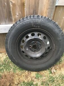 4 Winter tires 185/70 R14 on rims