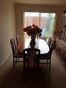 Immaculate Dining Setting with Extension Table