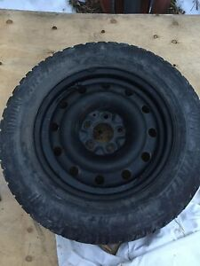 4 used winter tires on rims - used on Nissan Rogue