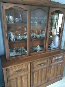 Solid wood hutch plus assorted crystal dishes.