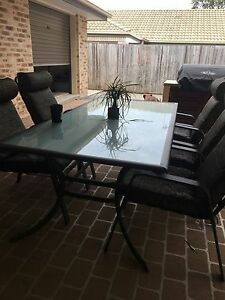 Glass outdoor table + 5 chairs Upper Coomera Gold Coast North Preview