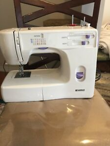 Sewing machine Kenmore excellent condition and working