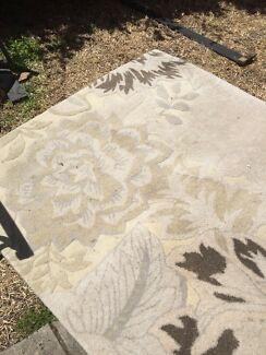 Cream coloured area rug