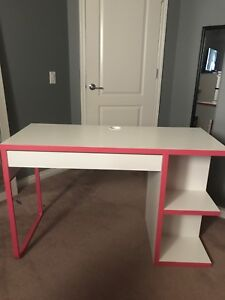 pink and white desk with matching pink chair