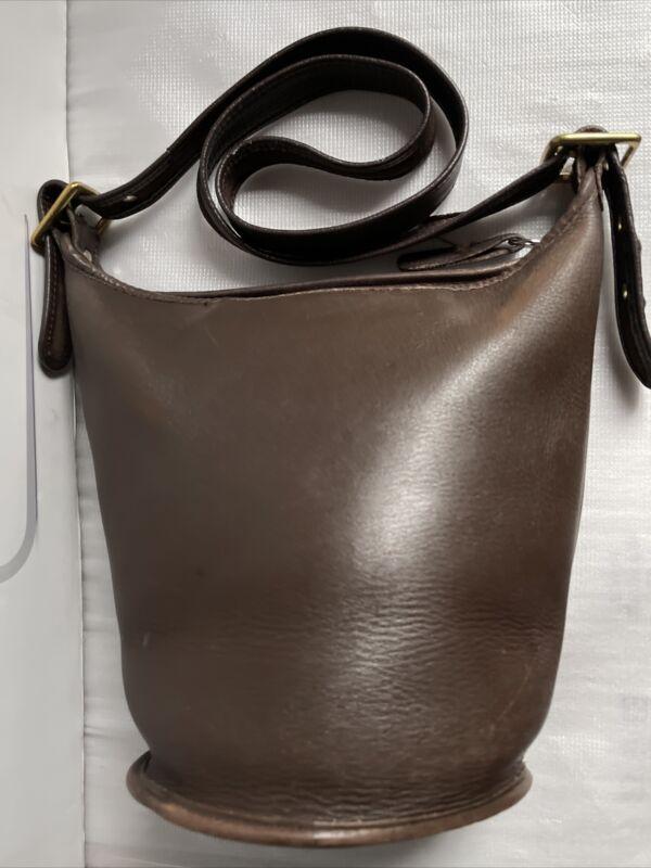 Coach Women's Brown Leather Bucket Crossbody Bag.Size: Medium