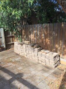 Approx 200 concrete pavers