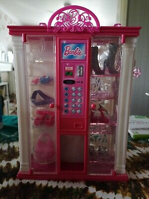 Barbie vending machine with accessories.