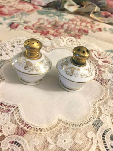 "Antique porcelain salt and pepper shakers, hand painted 2"" high"