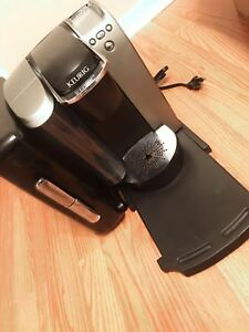 Keurig machine with pod holder