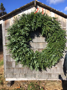 Wreaths, Christmas planters for sale.