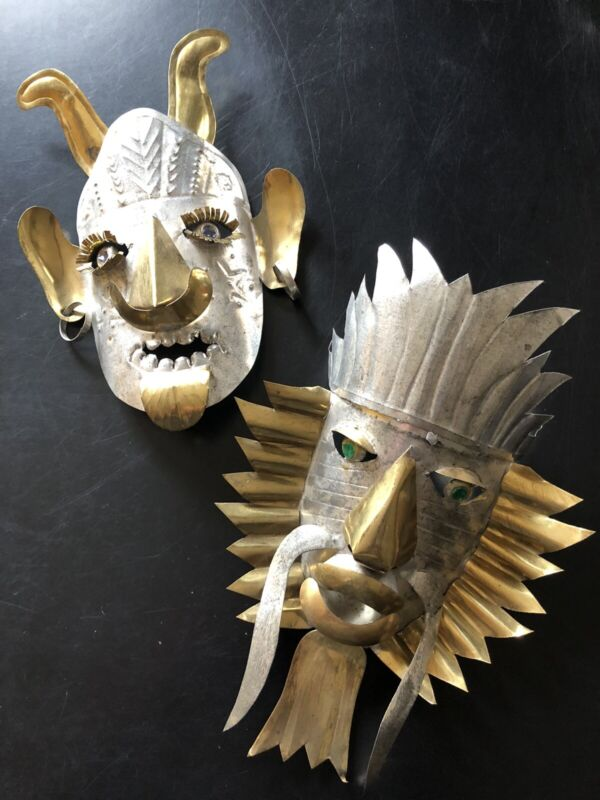 A SMALL PAIR OF VINTAGE HANDMADE TIN & BRASS TRIBAL MASKS MEXICO
