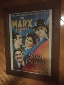 Old movie theatre art in glass and wood frame