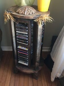 African swivel CD end table